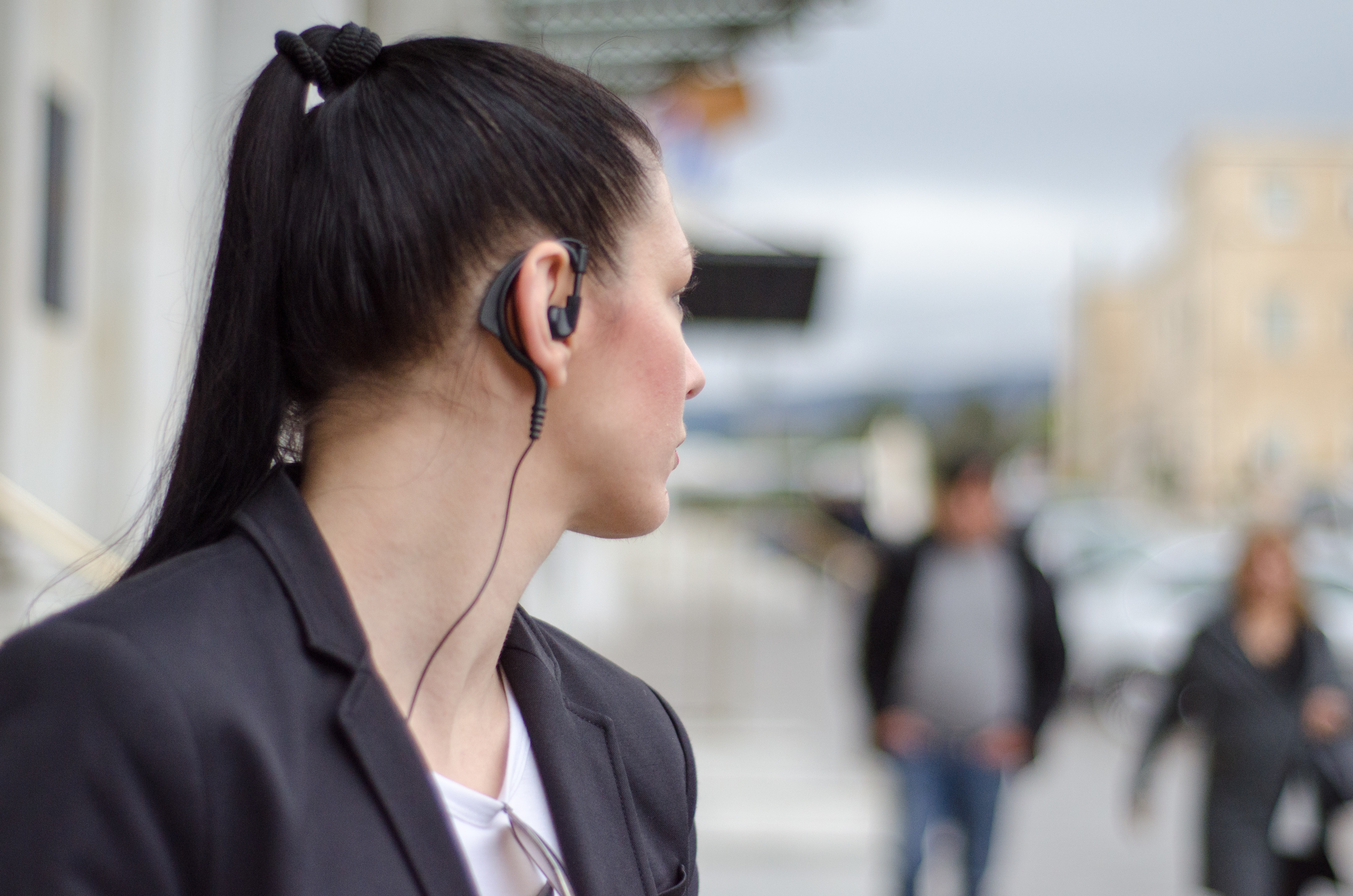 woman bodyguard with headset look at back